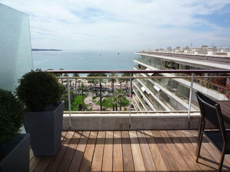 Beach and sea view from the terrace of a 2 bedroom Cannes group apartment in Grand Hotel