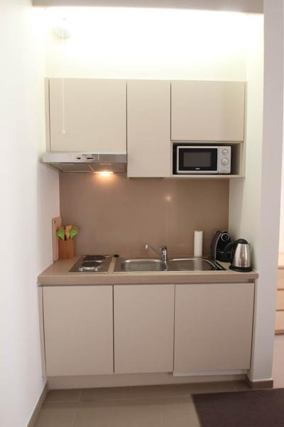 Open kitchen with microwave, coffee maker and stove