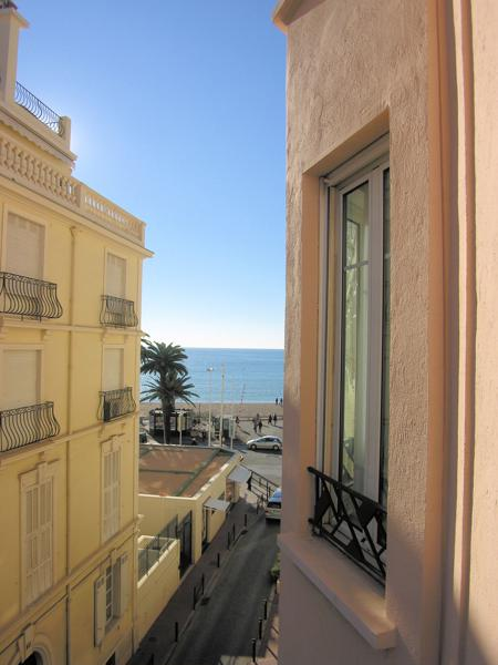 Street and sea view from a Cannes group apartment