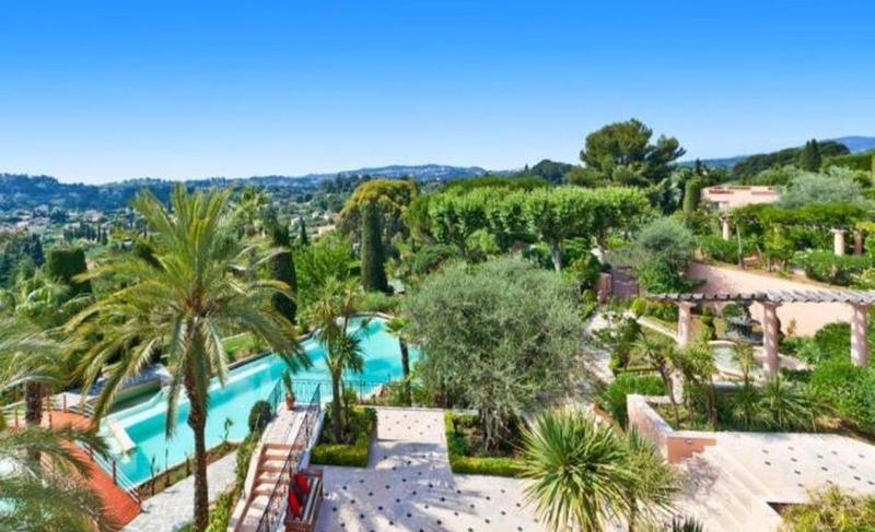 Top view of gardens, a swimming pool and surrounding mountains in a 9 bedroom Cannes party villa