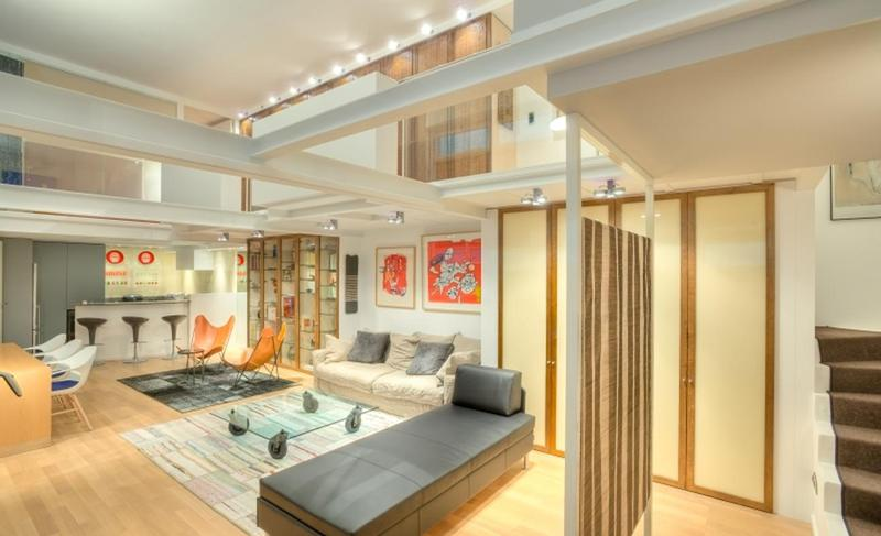Living room of a Cannes corporate rental apartment with office space including a conference table and a breakfast bar