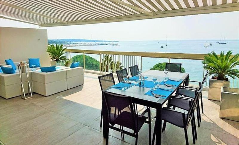 Couches on the terrace lounge with Mediterranean views in the seafront Cannes rental penthouse on Boulevard de la Croisette