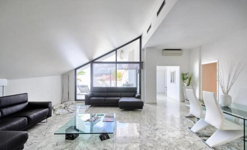 Living room overlooking the event terrace in a central Cannes 3 bedroom group penthouse