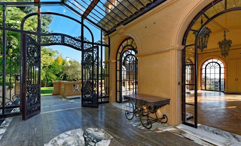 Hall with a metal gate for events and meetings in a Cannes group rental villa