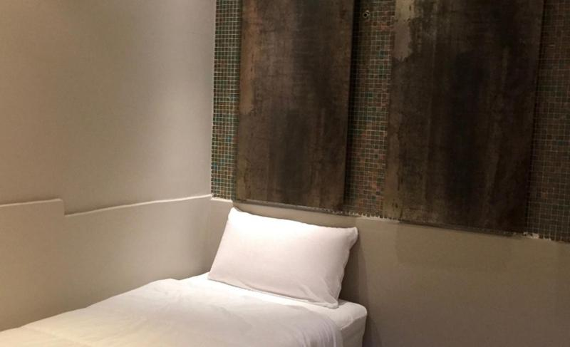 Single bed with white sheet and a pillow in 11 bed Cannes villa