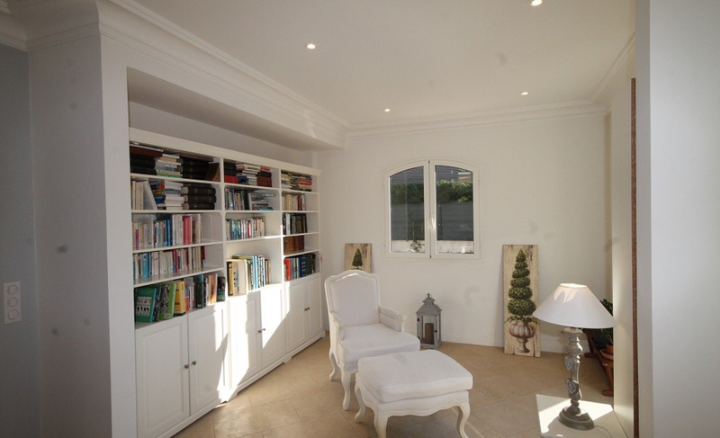 Bookshelves in a reading room in a Cannes Villa