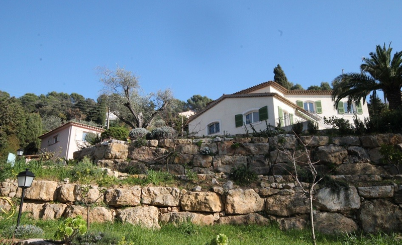 Frontal view of a Cannes event villa surrounded by natural trees