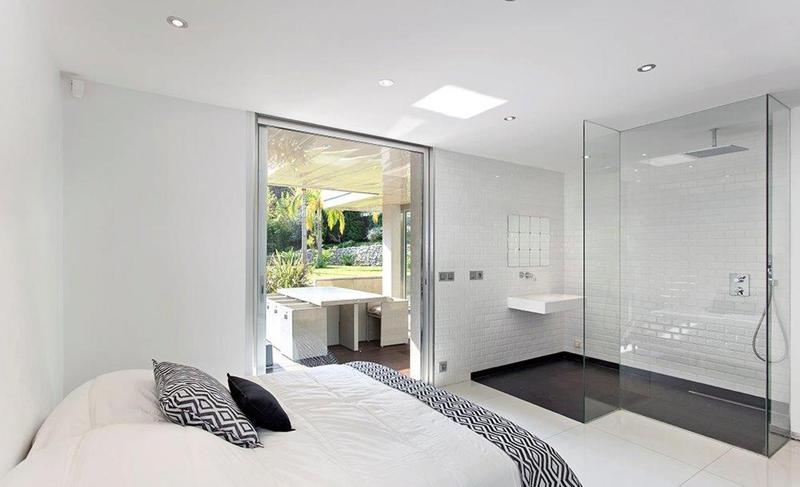 Double bathroom with open glass bathroom with shower and access to the outdoor garden in a Cannes villa