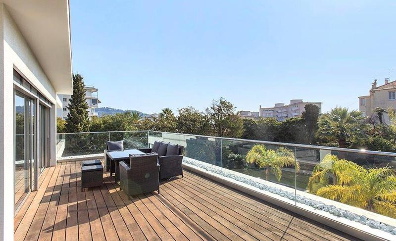 Outdoor deck furniture on the terrace with views in a Cannes rental villa