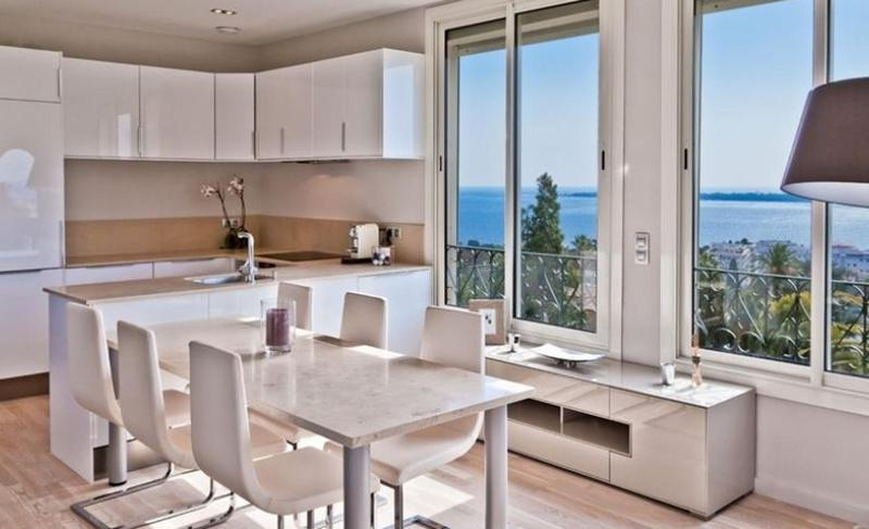 Open kitchen and dining area in Cannes group accommodation with views of sea