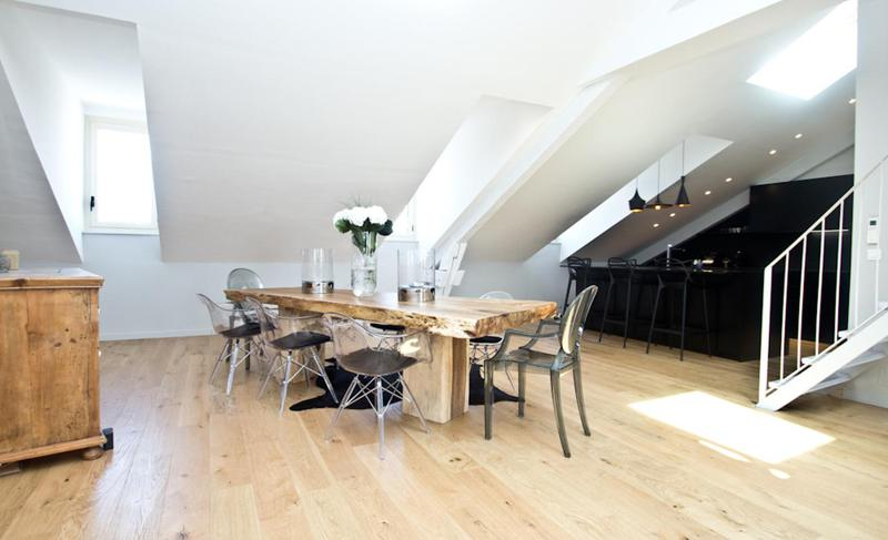 White painted open dining area and black coloured kitchen in the artistic living room in Cannes