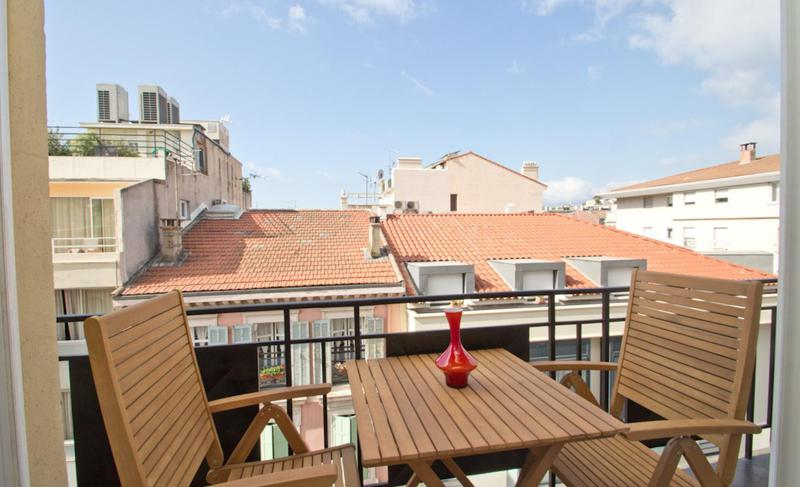 Table and 2 chairs on the terrace of a Cannes group apartment in Carlton-Martinez Area close to Palais des Festivals