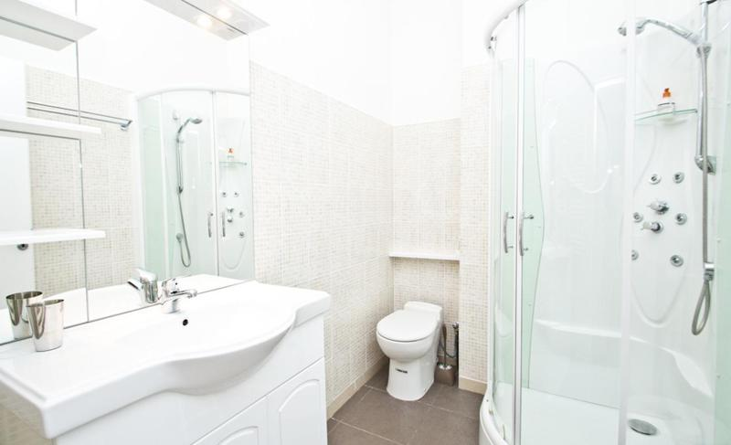 Bathroom with white interiors, sink and a standing shower in Cannes