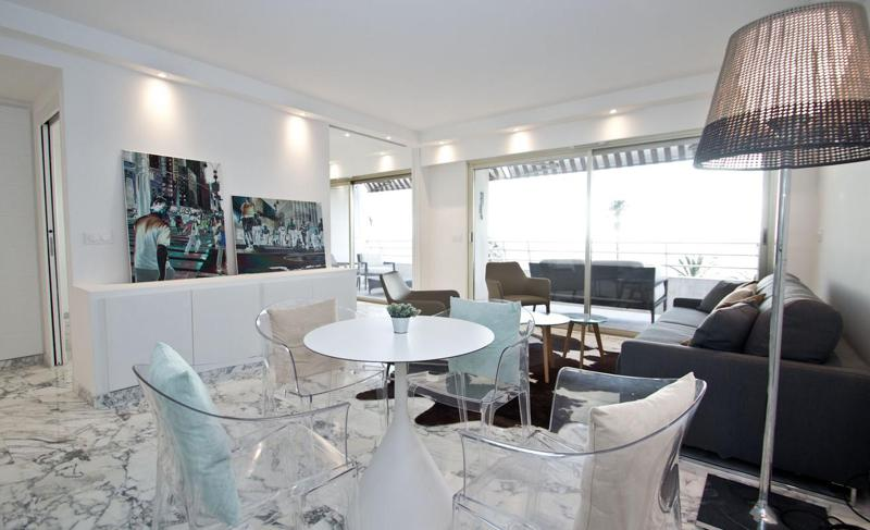 Furnished Cannes living room with wall paintings and a terrace right next to the sea