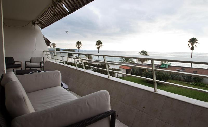 Couch and chairs on the terrace of a Cannes group accommodation with sea views