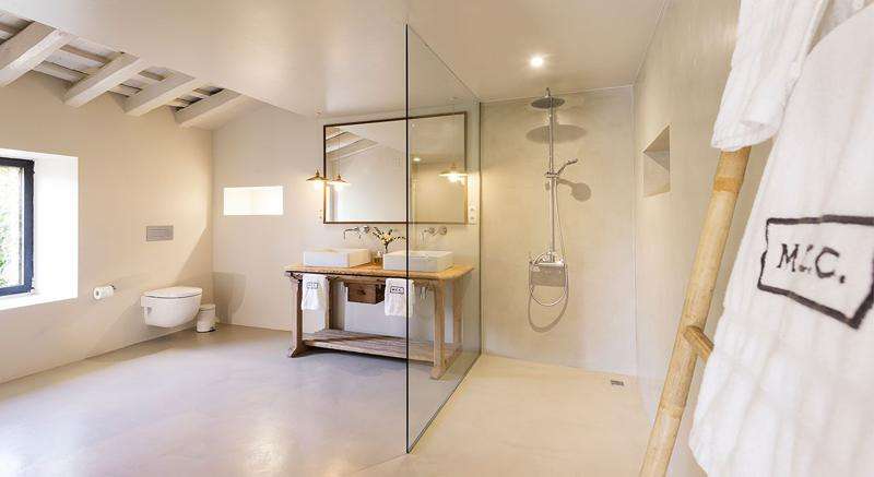 Bathroom with a window, glass door separated shower in a Barcelona villa