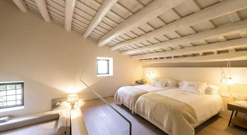 Bedroom with 2 single beds and a separate seating area with a couch in a Barcelona rental villa