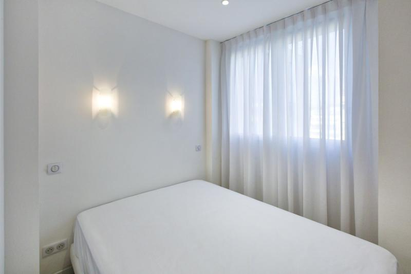 White curtains, bed and walls
