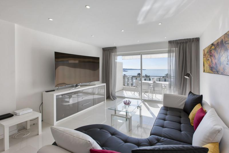 Modern living room overlooking the terrace with sea view in Cannes group apartment for rent in Grand hotel