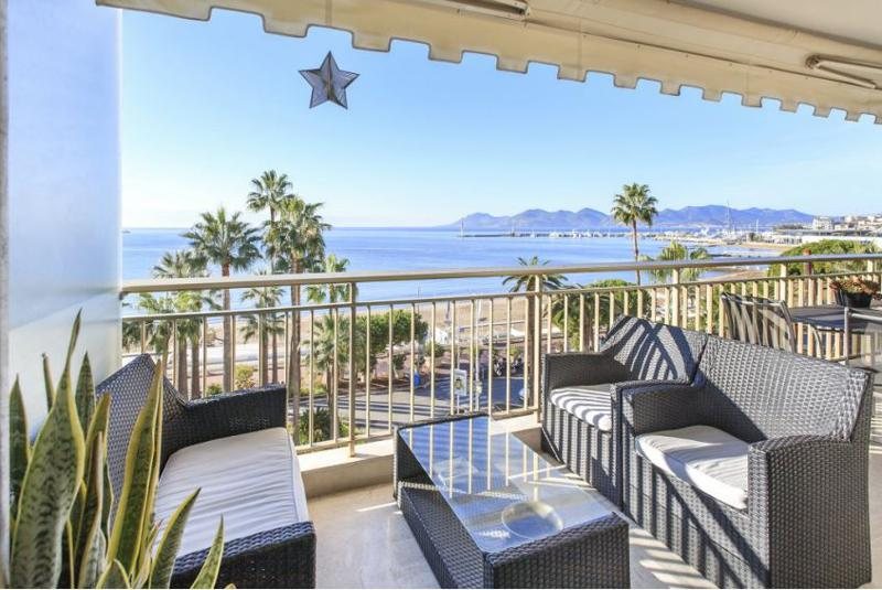 Black outdoor sofa set in the terrace of a Cannes rental apartment with sea views, near Palais des Festivals