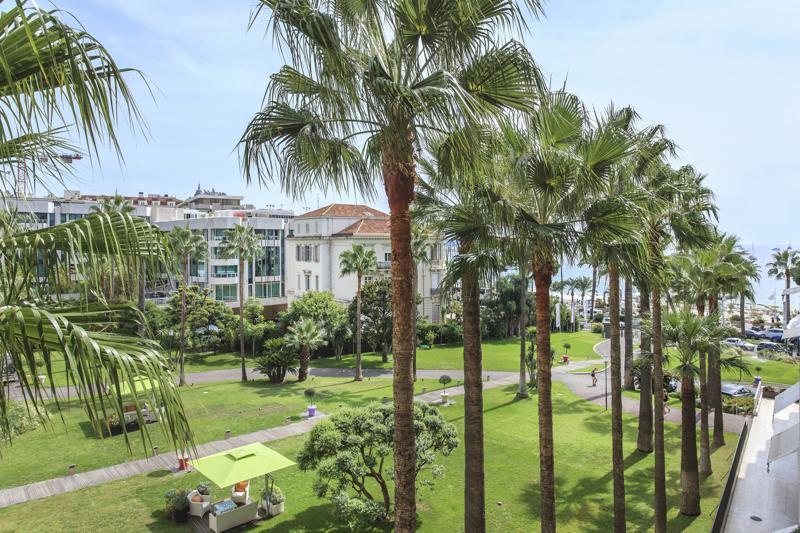 Views of garden and sea from the terrace of a Cannes group accommodation in Grand Hotel on Boulevard de la Croisette