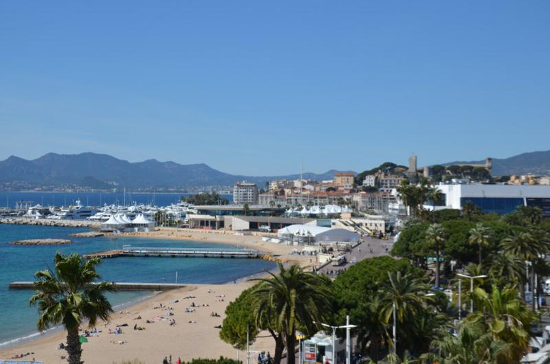 Views of Palais des Festival, city and the sea from the terrace of a Cannes 2 bedroom group accommodation on the Croisette