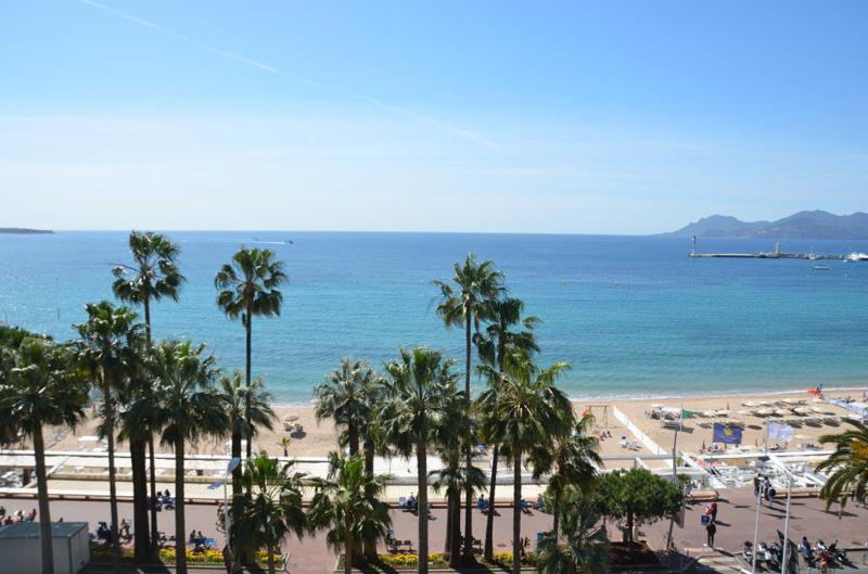 Sea and beach views from the terrace of a waterfront Cannes rental apartment on the Croisette de la Boulevard