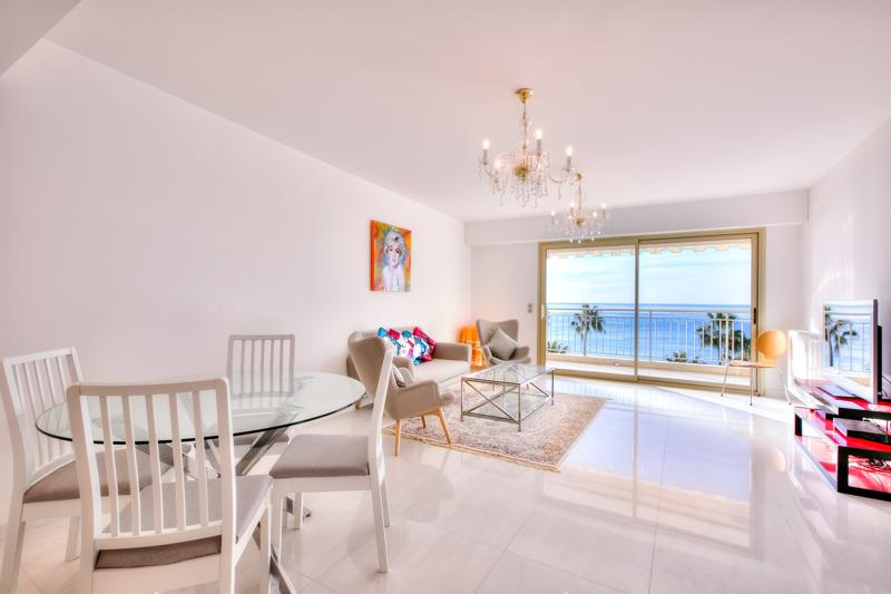 Beige coloured living room with sea views in a Cannes group apartment for rent on the Croisette near Palais des Festivals