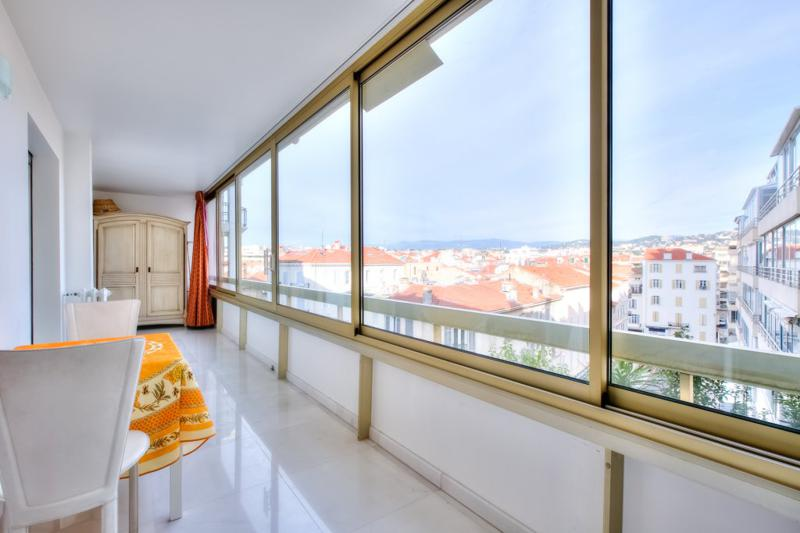 2 chairs and a table in the lobby overlooking the entire city in a Cannes rental apartment on the Croisette for groups