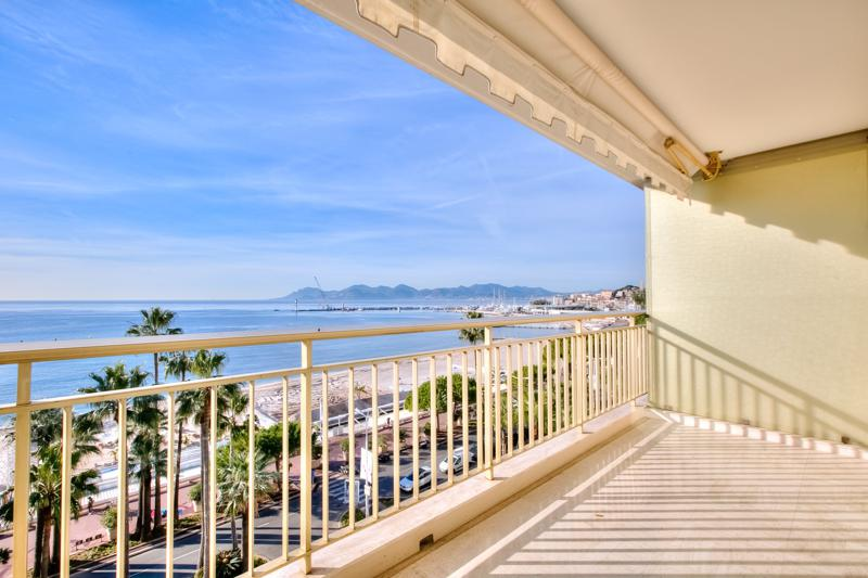 Views of the Mediterranean and the beach from the terrace of a Cannes rental apartment by the sea