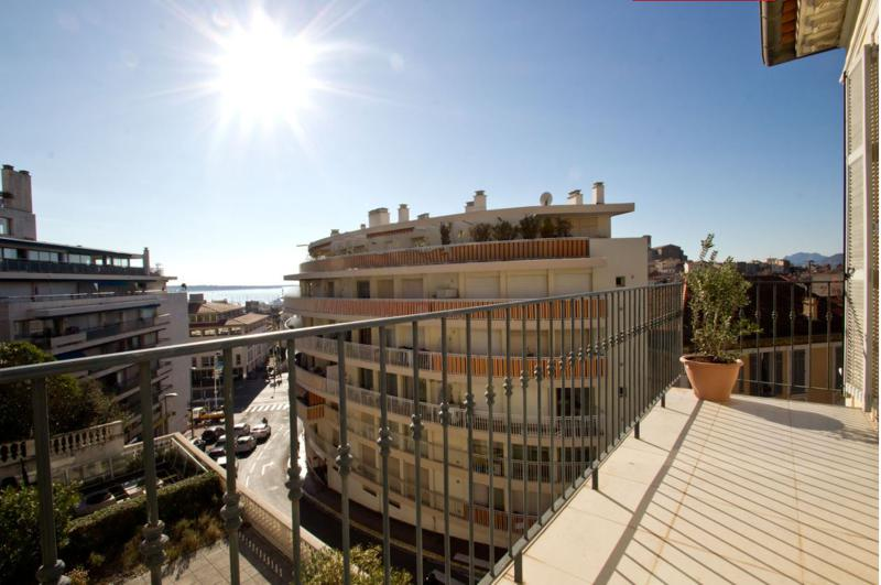 City and sea views from the terrace of a 2 bedroom Cannes group accommodation near the convention centre