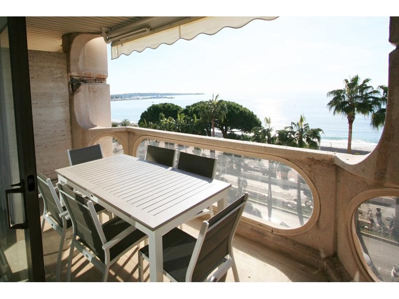 Outdoor dining table with chairs on the terrace of 2 bedroom Cannes event accommodation by the sea