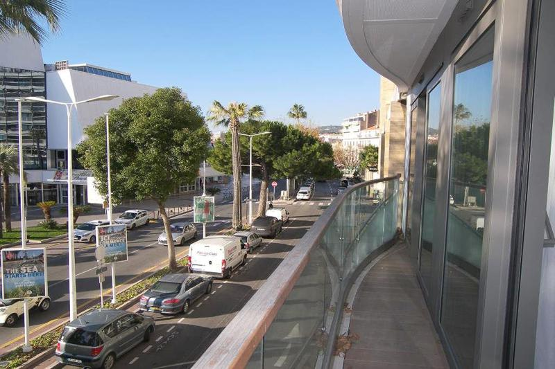 Street views from the balcony of a Cannes rental apartment facing convention centre