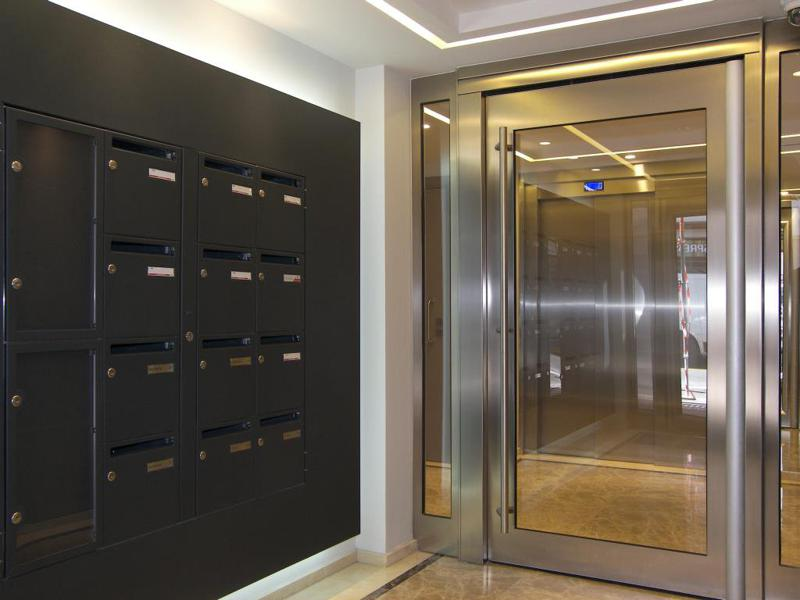 Building lobby with letter boxes and glass door in Cannes