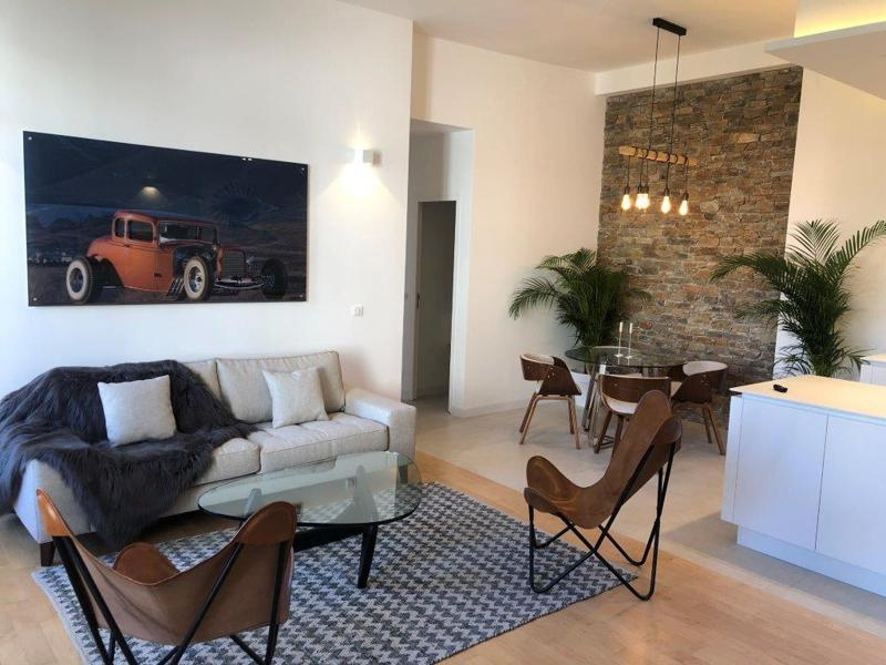 Cannes rental group accommodation with a furnished living room, a dining area and an open concept kitchen