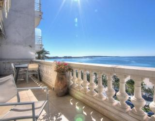 Panoramic sea views from the spacious terrace of a 2 bedroom Cannes rental accommodation on the Croisette.