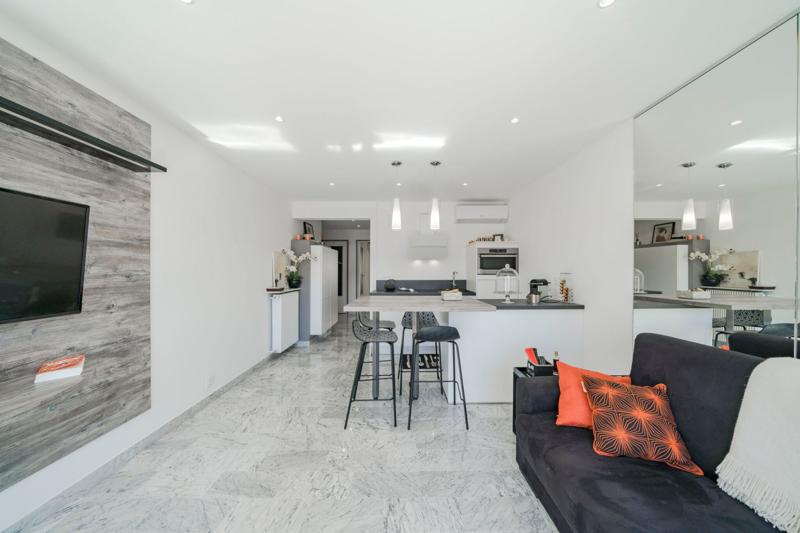 Marble flooring in the modern living room with open kitchen in a Cannes 2 bedroom rental apartment near the convention centre