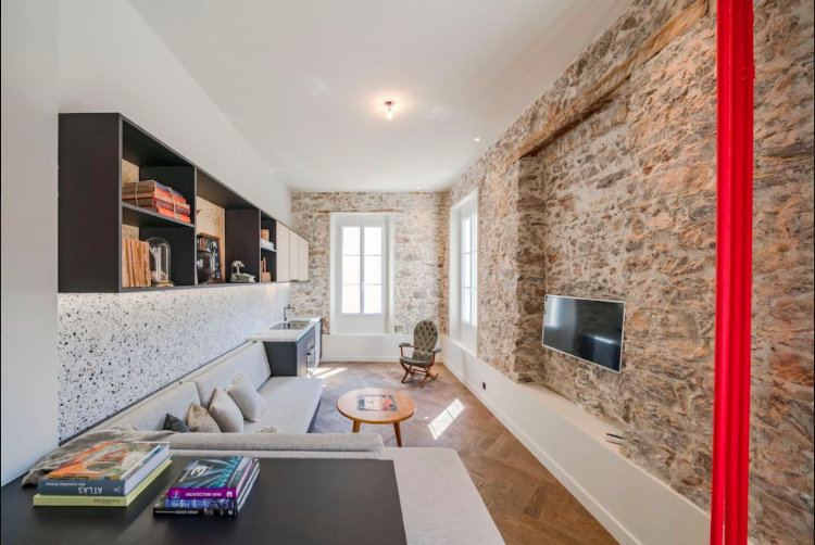A flat-screen tv facing the couch sets in the spacious living room of a Cannes 1 bedroom corporate accommodation for rent
