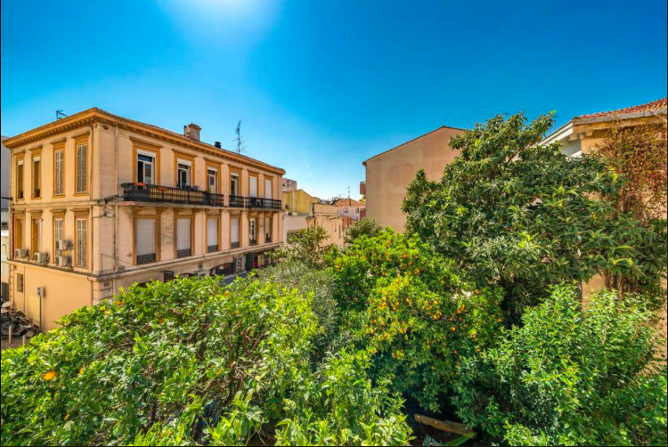 View of beautiful Cannes building and park from a 1 bedroom Cannes rental apartment with mezzanine.