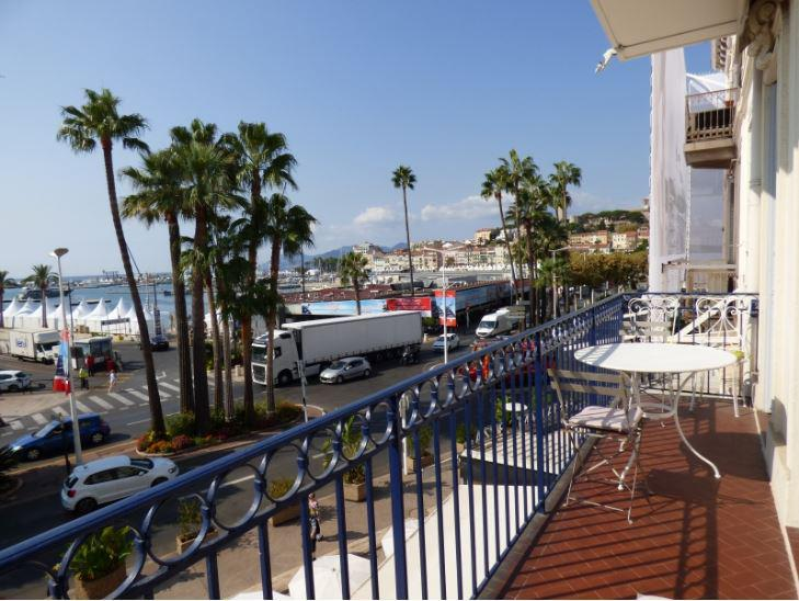 Old port, convention centre and city views from the terrace of a Cannes rental apartment in Le Suquet area