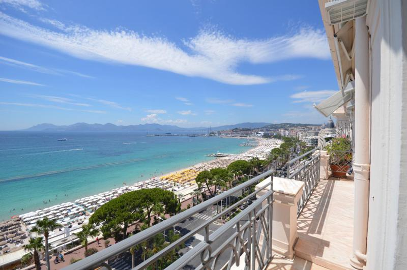 Views of beach and sea from the terrace of a Cannes event penthouse