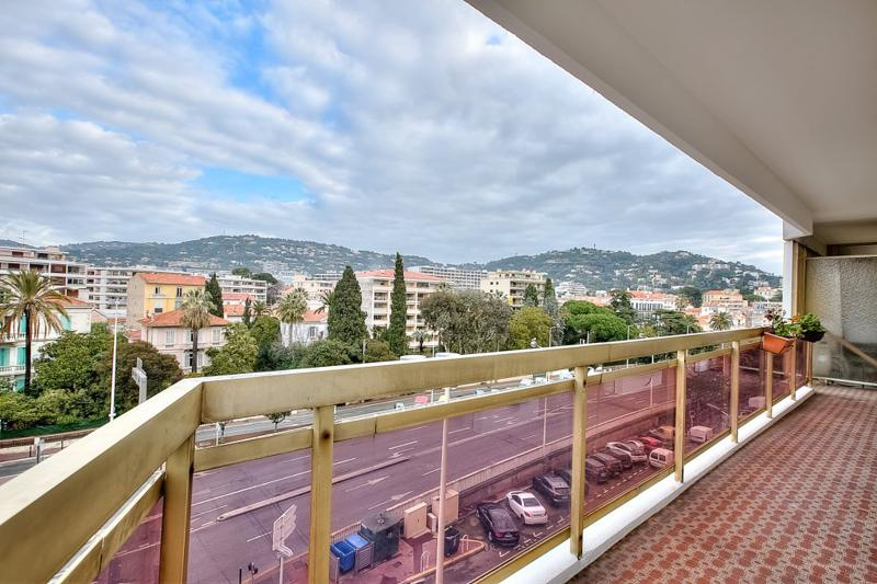 City and mountain views from the long terrace of a Cannes group accommodation close to Palais des Festivals