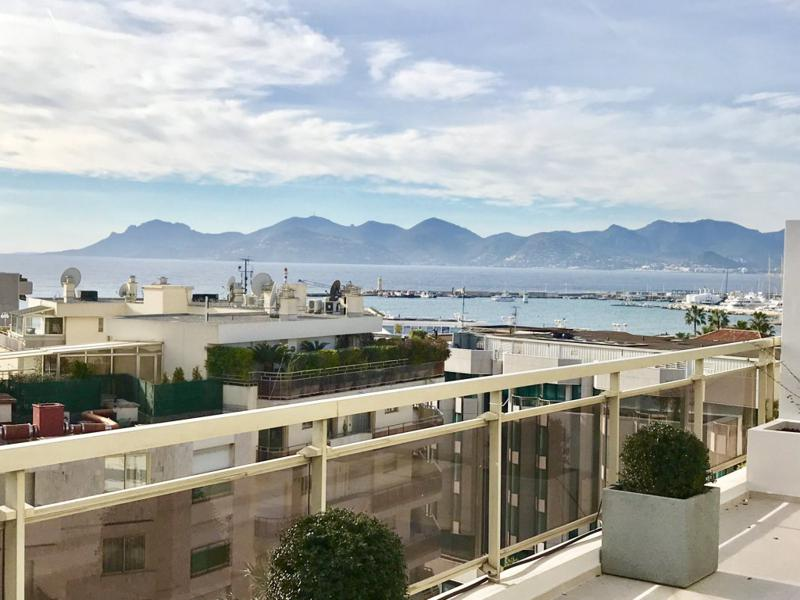 Views of Mediterranean and the mountains from the terrace of a Cannes group penthouse for parties and events