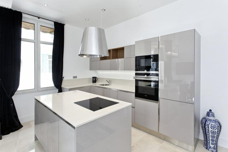 Kitchen with microwave, oven and induction stove in Cannes