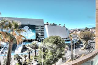 View of the Cannes conference centre from the terrace of a 4 bedroom rental apartment for groups.