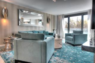 Blue velvet couches with matching carpet in a 4 bedroom Cannes group apartment facing the Palais des Festivals.