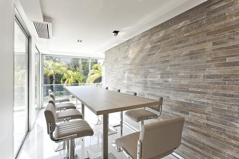 Meeting room with a corporate table and leather chairs in a Cannes event villa for rent