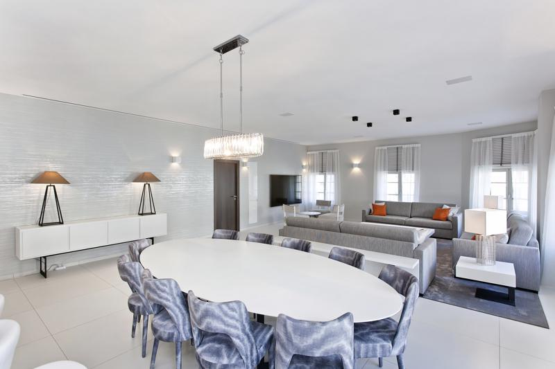 Living room of a Cannes group penthouse accommodation with dining table for meetings