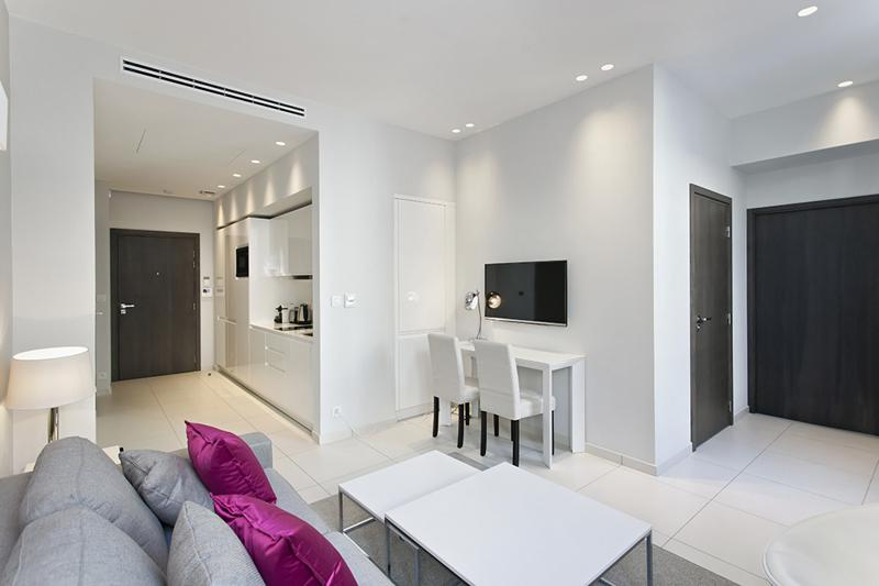 Living room and open kitchen in a 1 bedroom Cannes event accommodation in a building close to Palais des Festivals