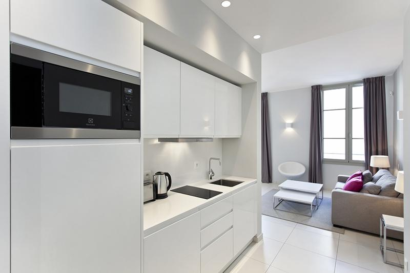 Open kitchen with a microwave, a toaster and a coffee machine in a 1 bedroom Cannes rental accommodation